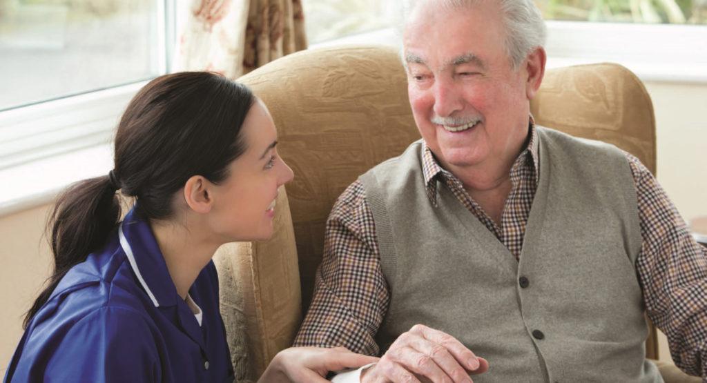 Employee Assisting Elderly Gentleman