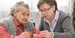 Employee Assisting Woman in Memory Care